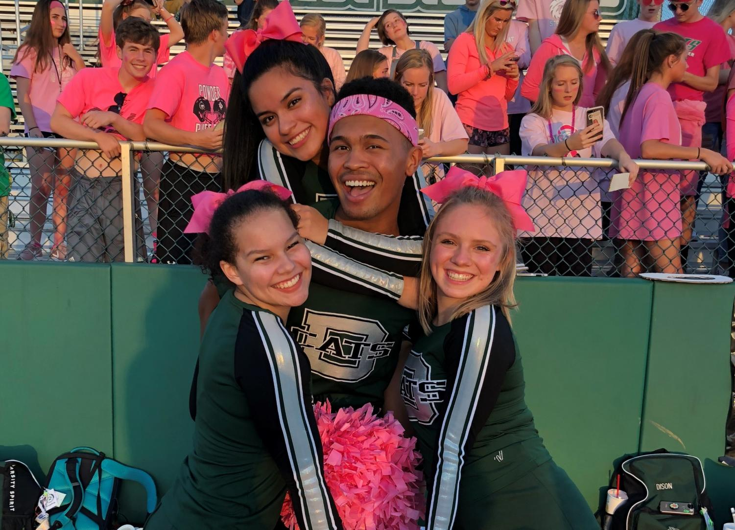 Senior captains Lexi Marshall, Aylin Rocha, Zekkiah Hird and Ellie Fowks pose for a photo prior to cheering at a home football game against Basehor-Linwood on Oct. 5.