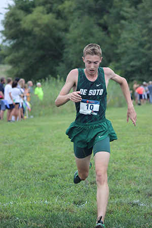 Freshman Clayton Tilley crosses the finish line during the first home cross country meet at Lexington Lake on Sept. 6, 2018.