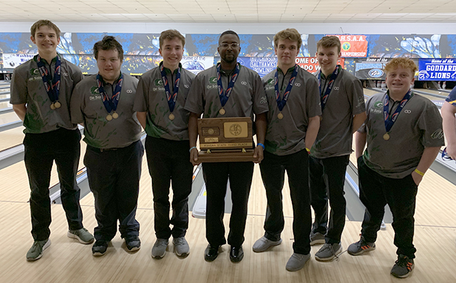 Boys' bowling team stands proudly holding their third place trophy at the state tournament. on Feb. 28.