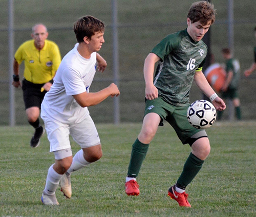 Senior Daniel Apple prepares to battle for the ball during his 2018 season. Despite difficult injuries that kept him from soccer for a year, Apple signed to play at Baker University in the fall.