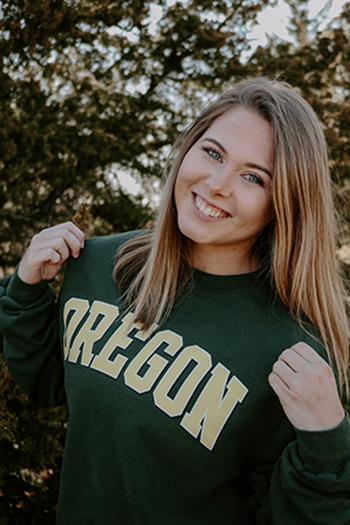 Senior Caroline Whipple sports her University of Oregon sweatshirt after deciding on the school.