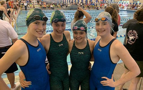 Sophomore Nicole Schottler, freshman Josephine Butler and sophomores Lynlee Hutchison and Liz Schottler pose for a picture after competing in the 200-meter relay at the State competition on May 18.