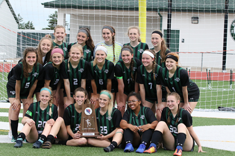 The DHS Varsity girls' soccer team celebrates winning the UKC title on May 7, 2019.