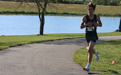 Freshman Landen Lawson races during De Soto High School home meet at Lexington Lake Park on Sept. 13.