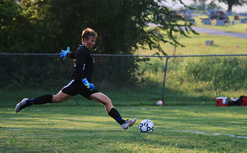 Senior varsity goalkeeper Eli Gratz takes a goal kick in the Wildcats season-opening home contest vs. Topeka-Seaman on Sept. 3.