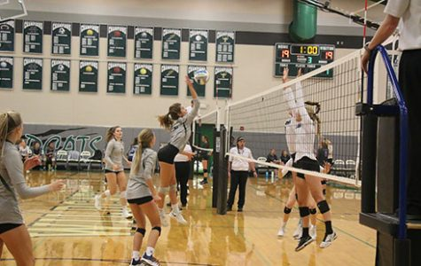 Freshman Erin Barr approaches for a kill at the match versus Louisburg on Sept 5.