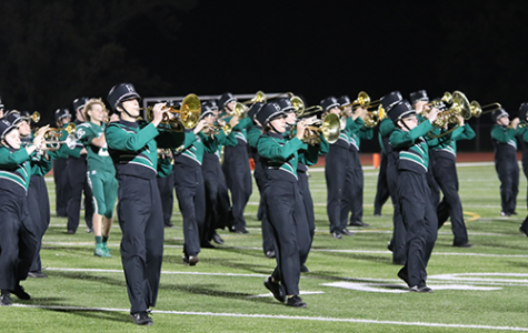 The De Soto high school marching band performs during halftime at the Homecoming game on Oct. 18, 2019.