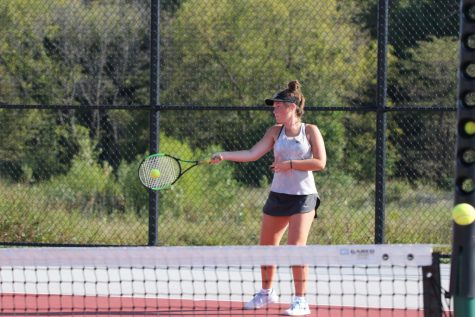 Junior Hallie Scott makes contact with the ball on her forehand at Lansing Quad on Sept. 26.