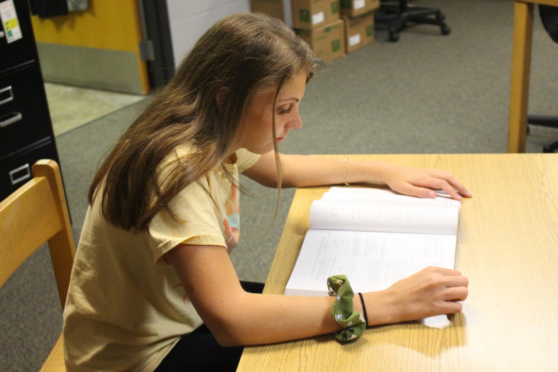 Junior Natalie Nusz studies for the upcoming PSAT.