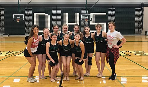Members of the Diamonds dance team take a picture with the Kansas City Chief's cheerleaders ,after their choreography session.
