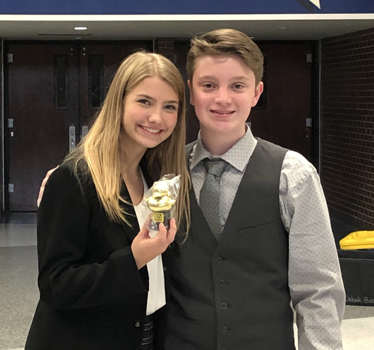 Freshmen Lydia Crest and mason Scott pose with their sixth place trophy at Olathe South High School.