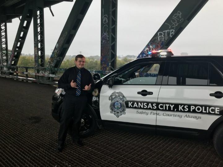 Senior+Lucas+Beggs+poses+next+to+a+police+patrol+vehicle+in+Kansas+City%2C+Kansas.
