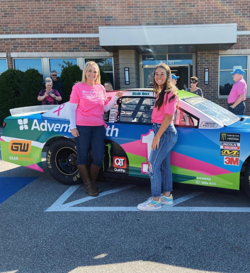 Junior Ella Boxx celebrates her mom, Nicole Boxx, after being chosen to be the spokeswoman at the AdvantHealth NASCAR event at the Shawnee Mission Medical Center on Oct. 18.