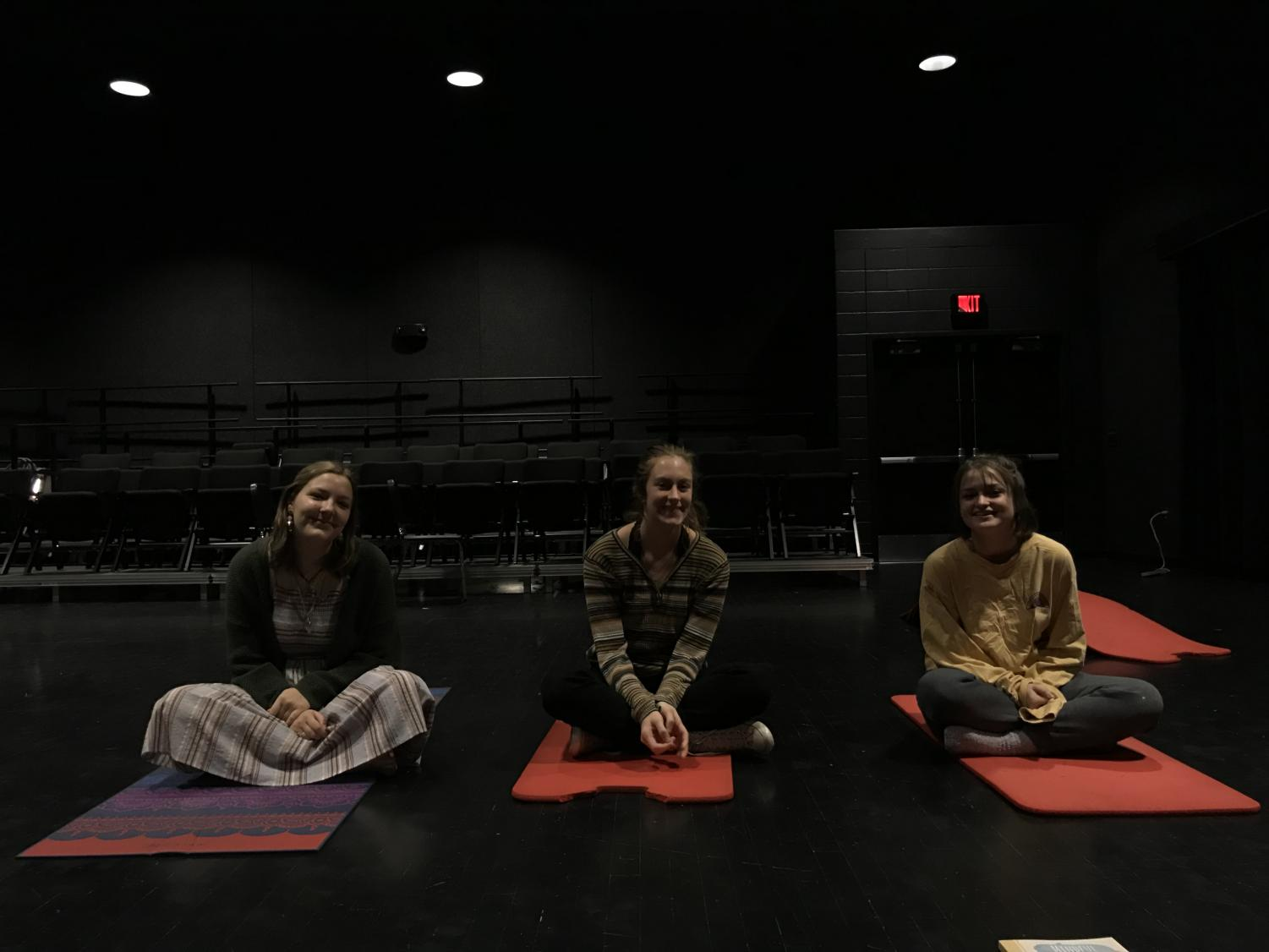 Senior Sydney Ames leads Mindful Mornings with other leaders Hayley Moss and Aspen Grieshaber.