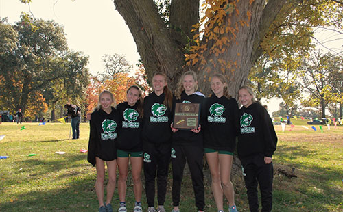 The De Soto High School girls cross country team poses with their regional championship trophy at the Regional cross country meet on Oct 26.