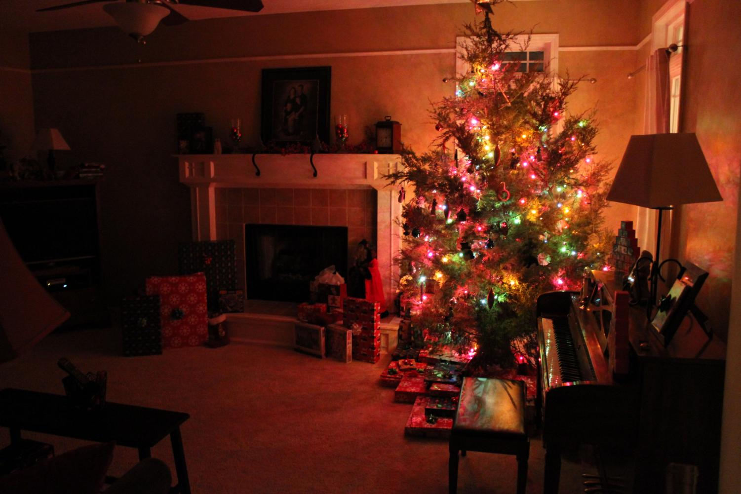 A Christmas tree is displayed with gifts surrounding.