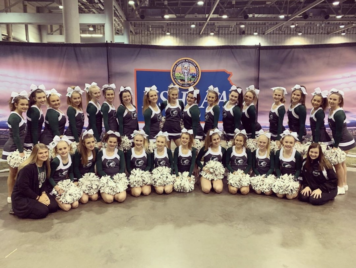 De Soto Cheer team takes photo at State competition on November 23, 2019.
