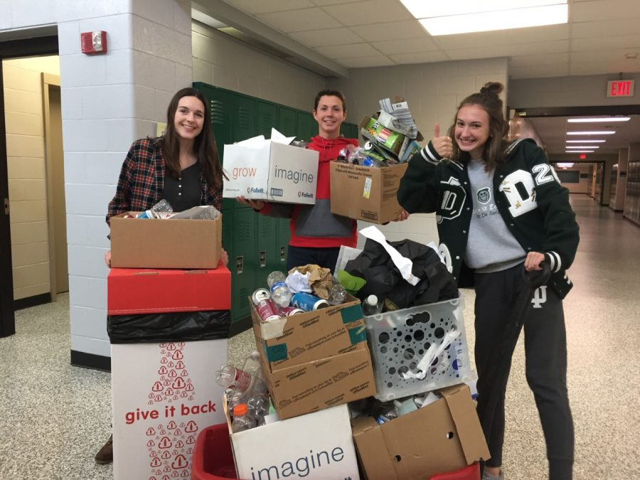 Senior Austin Bradley collects recyclable material for the Environmental Club with seniors Erin Pickert and Lauren Stanton.