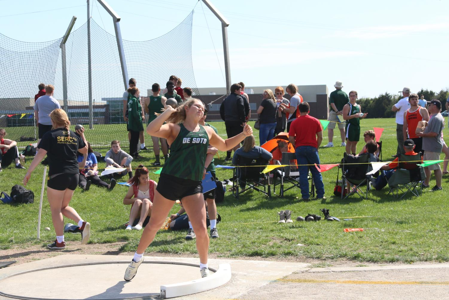 Senior Emily Fuhr throws shot put at a home track meet in the spring of 2019.