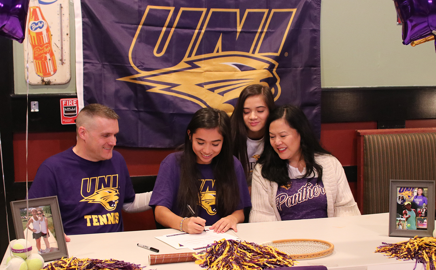 Senior Issa Sullivan signs her national letter of intent to play college tennis at the University of Northern Iowa at a ceremony with family and friends on Dec. 6, 2019.