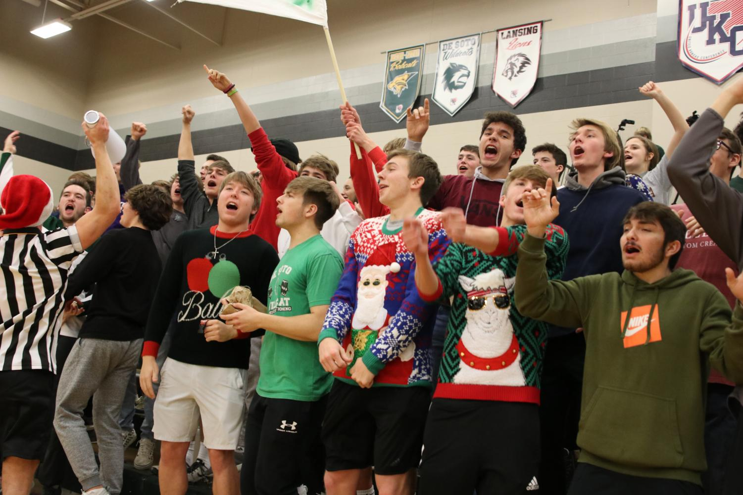 The DHS student section cheers as the boys' team wins against Bonner Springs on Dec 20.