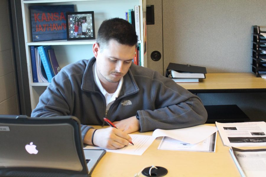 Bennett Ratzloff grades his World Geography students' assignments on Feb. 11, 2020.