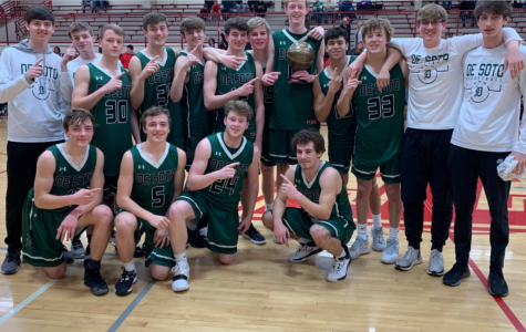 The De Soto high school boys' basketball teams celebrates its championship after winning the Tonganoxie Invitational on Jan. 25.