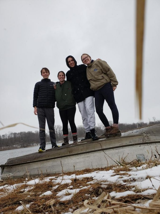 De Soto High School seniors Jack Loomis, Morgan Laney, Matthew Lingner, and Lauren Mallicoat pose for a photo by the lake behind the cabin in Iowa. Picture by Lauren Mallicoat