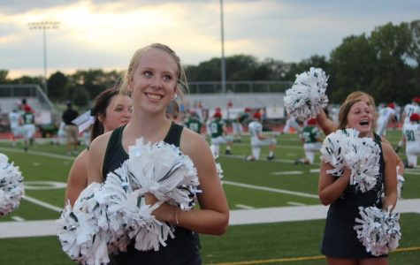 Senior Mya Conley works with her cheer teammates during Fall Fest at the De Soto High School  football field on August 23, 2019.
