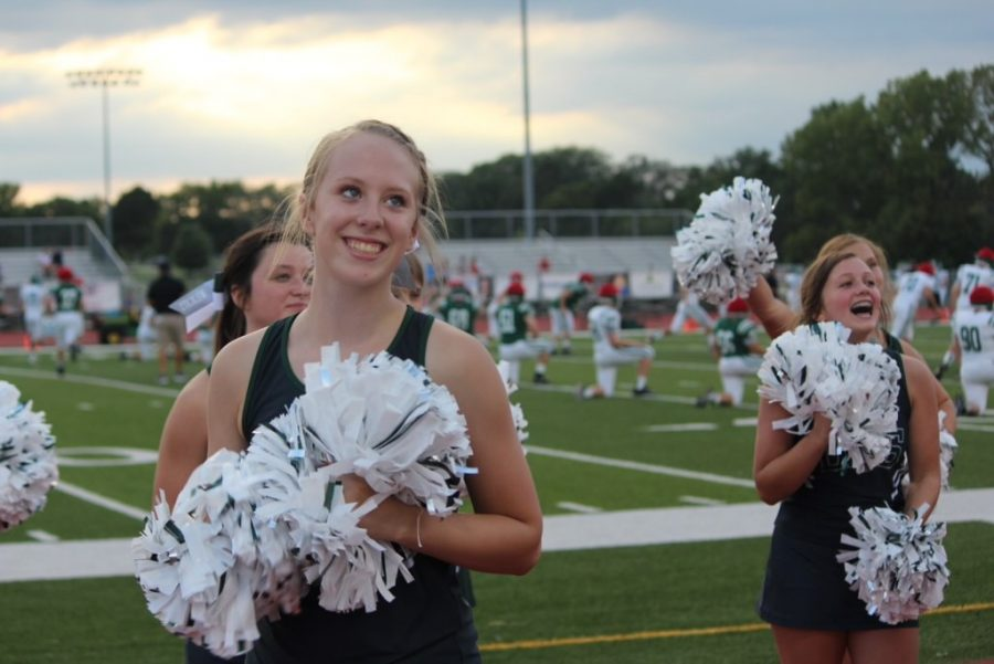 Senior+Mya+Conley+works+with+her+cheer+teammates+during+Fall+Fest+at+the+De+Soto+High+School++football+field+on+August+23%2C+2019.