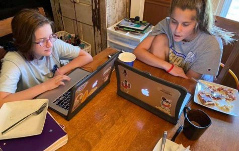 Senior Kyra Halvorsen spends time with her younger sister on April 1 completing online coursework throughout the COVID-19 quarantine.