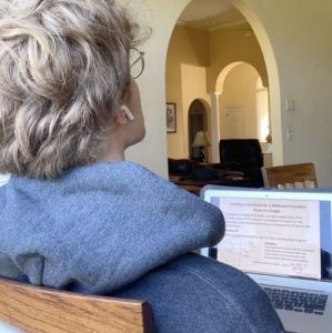 Junior Egan Putman watches a virtual math lesson on his laptop from home on April 21.