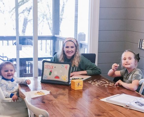 Caroline Friday and her children, Harper and Hudson Friday, work on virtual school at home on April 17.