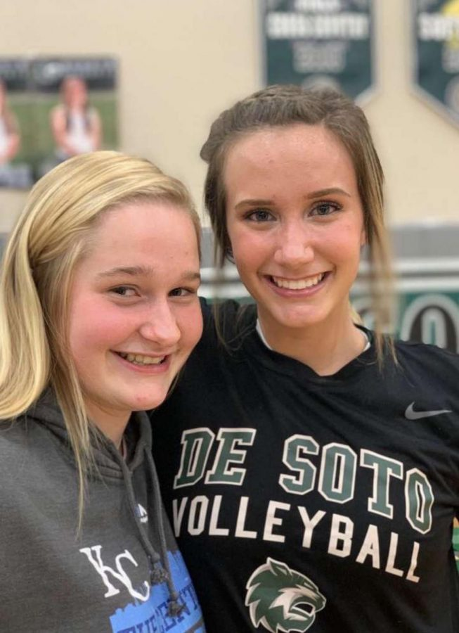 Senior Taylor Ellis and freshman Anna Haswell pose for a photo after a home volleyball match on Oct 15.