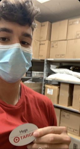 Senior Hugo Nascimento working at Target with the required mask on May 19