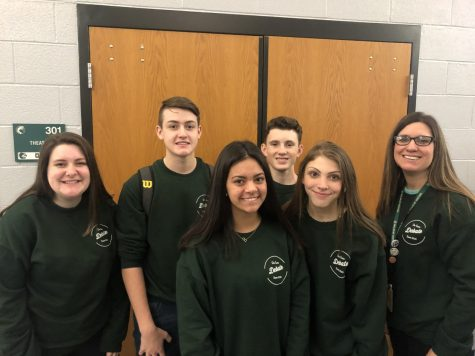 Inga Kelly poses with junior debate State qualifiers Hunter Finerty, Blake Hinson, Brooke Cobos, Natalie Nusz and Ryan Handley before leaving for the State competition on Jan. 17-18 at Hutchinson High School.