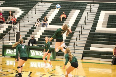 Senior outside hitter Brooke Stonestreet goes up for an attack in the Wildcats victory over Shawnee Mission North on Sept. 17.