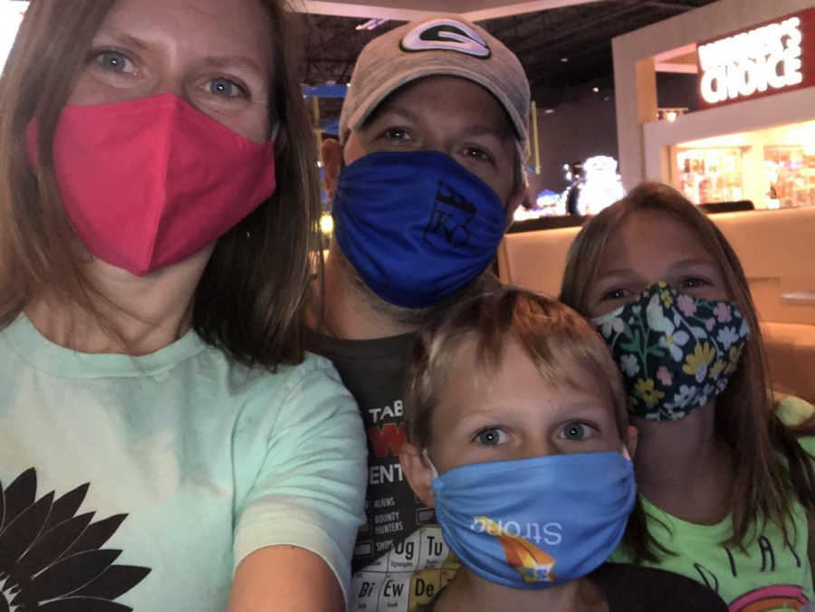 DHS+social+studies+teacher+Cathryn+Monroe+and+her+husband%2C+daughter+and+son+pose+for+a+selfie+while+wearing+their+masks.