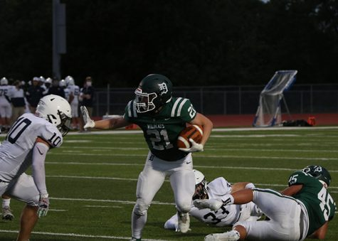 De Soto High School senior running back Tyson Priddy avoids a Mill Valley defensive player during Wildcats loss to the Jaguars on Sept. 11.