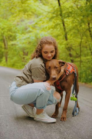 Junior Shelby Marquis goes on a walk with her dog on May 14
