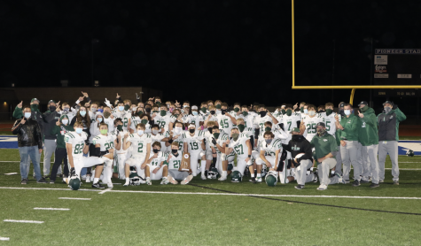 The De Soto High School football team celebrates its second straight United Kansas Conference title after defeating Leavenworth on Oct. 16.