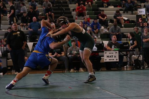 Junior Owen Nehl attempts a take down his opponent during last year