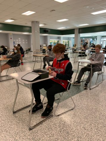 Freshman Bayler Bell sits independently during his lunch period on Jan. 20.