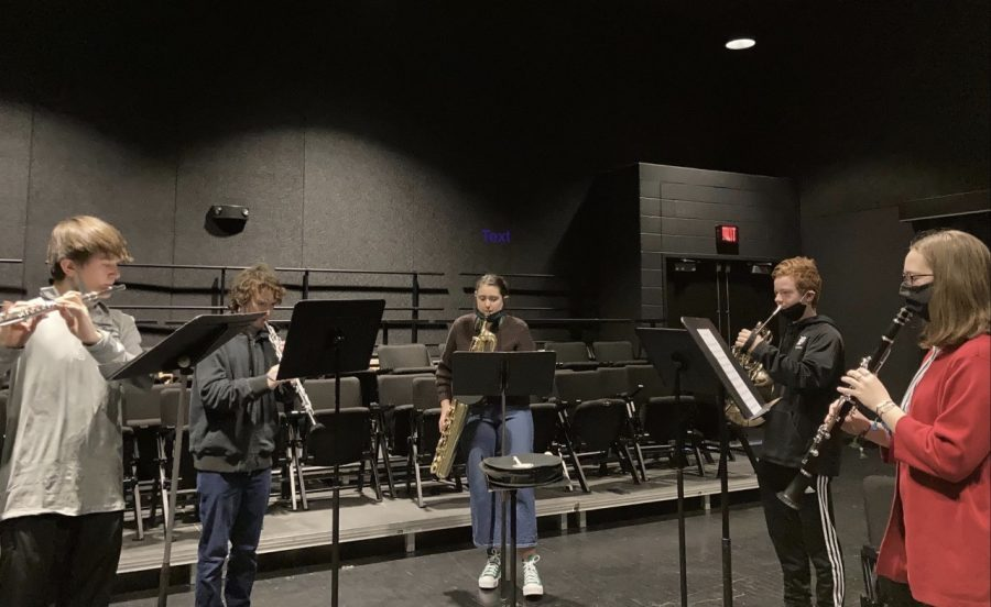 Sophomore Trever Tilton, juniors Casey O'Donnell and Ollie Kellogg, sophomore Ryan Lange and senior Emily Kresin rehearse their piece in the Black Box Theatre on March 1 for their upcoming ensemble performance.