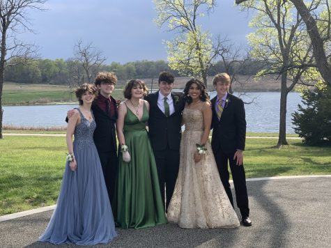 A group of junior students poses for their prom pictures on April 17, 2021.