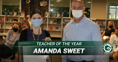 Kansas Teacher of the Year nominee Amanda Sweet poses with principal Sam Ruff after being presented with a plaque.
