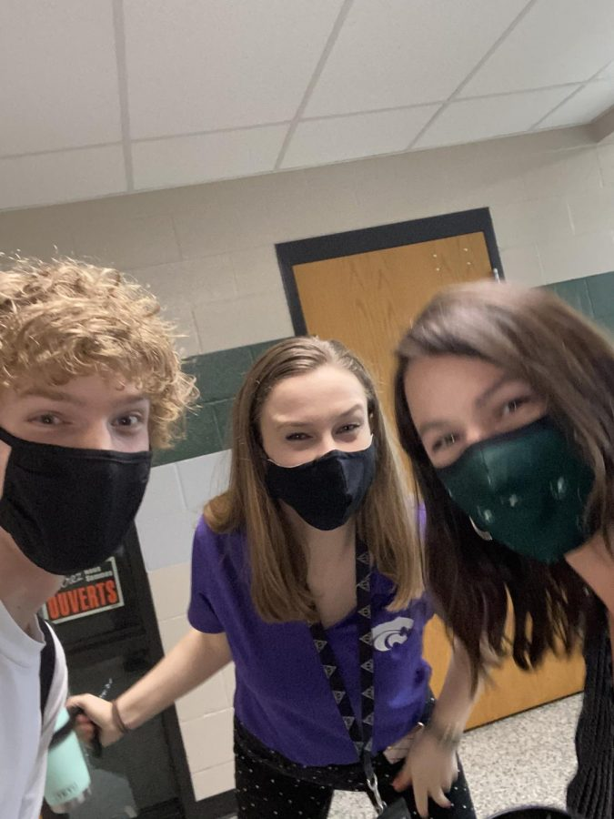 Senior Egan Putman smiles for a hallway selfie with Spanish teachers Jessica Pennybacker and Lindsay O'Neil. Putman, who has been O'Neil's Spanish student for two consecutive years, will be graduating this year with the rest of the class of 2021.