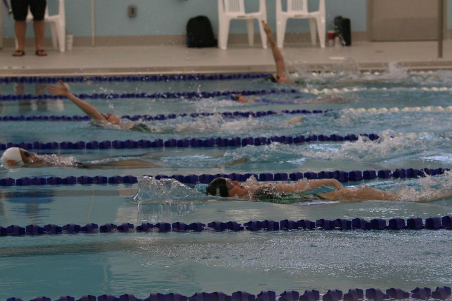 The DHS girls' swim team competes at a meet on April 6, 2021.
