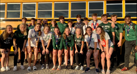The De Soto Varsity Track team poses for a picture after competing at State on May 27, 2021.