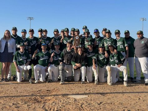The De Soto High School varsity baseball team celebrates after becoming the United Kansas Conference champions on Thursday, May 7.